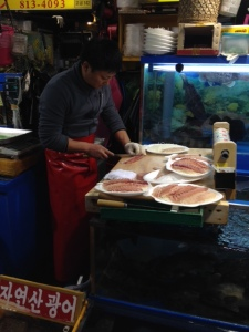 Guy is preparing sashimi