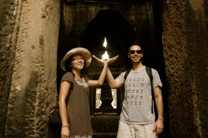 Preah Khan: Our hands make up a candle. The gap in the stone is like a flame.