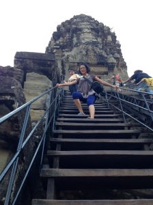 Climbing down the stairs from Angkor Wat