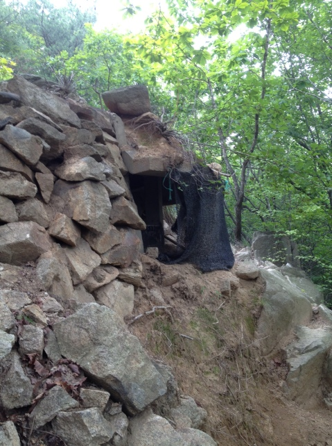 Pillbox with loopholes for machine guns