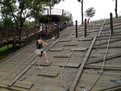 Bridget climbing up using ropes