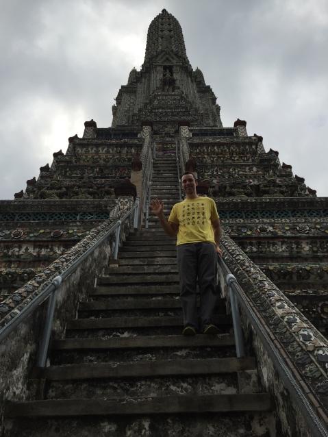Alex climbing up Wat Arun