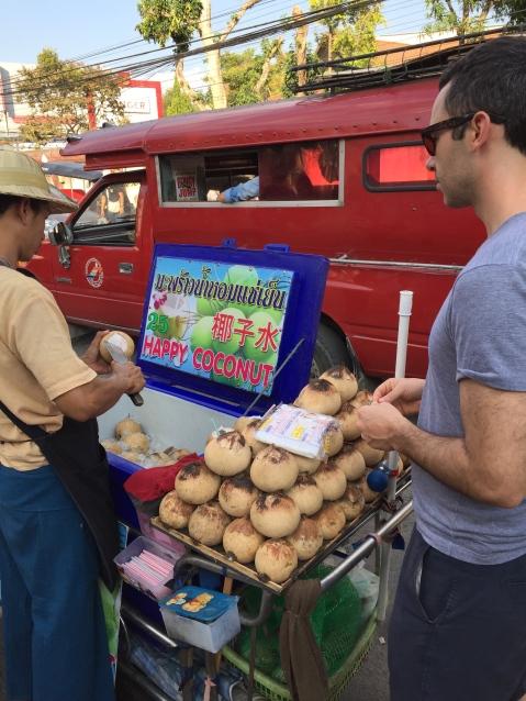 Alex getting a fresh coconut drink