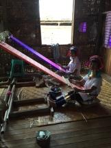 Long necked women weaving